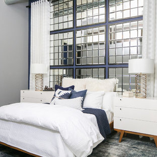 Example of a mid-sized urban medium tone wood floor and gray floor bedroom design in Denver with blue walls