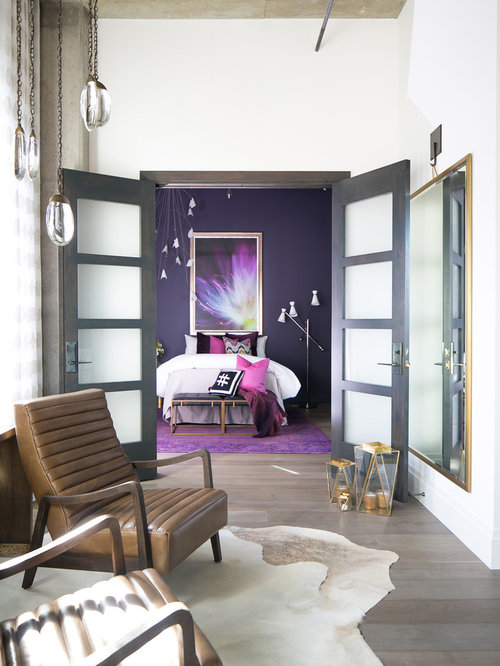 Inspiration For A Mid Sized Industrial Medium Tone Wood Floor And Gray  Floor Bedroom Remodel