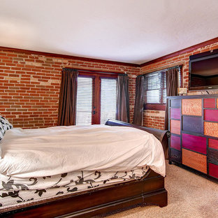 Example of a mid-sized eclectic master carpeted bedroom design in Denver with a two-sided fireplace and a tile fireplace