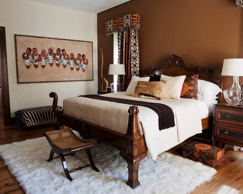 Example Of A Trendy Bedroom Design In Denver With Brown Walls And Medium Tone Hardwood Floors