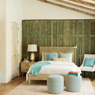 Mid-sized trendy guest medium tone wood floor bedroom photo in Los Angeles with beige walls