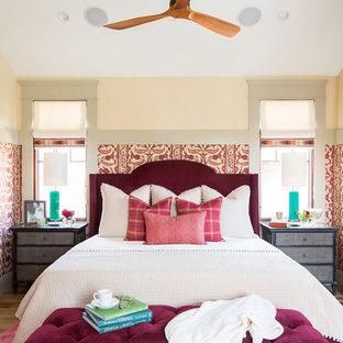 Example Of An Eclectic Medium Tone Wood Floor And Brown Floor Bedroom Design  In San Diego