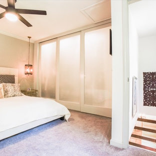 Example of a large transitional master carpeted and brown floor bedroom design in Atlanta with beige walls and no fireplace