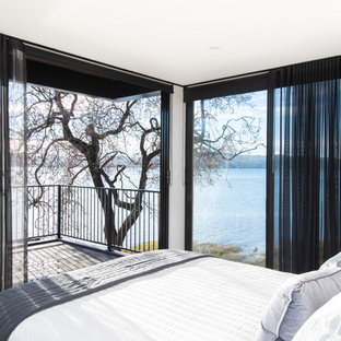 Design ideas for a contemporary bedroom in Other with white walls.