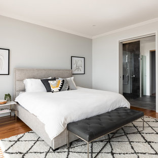 Contemporary master bedroom in Perth with grey walls, medium hardwood floors and brown floor.