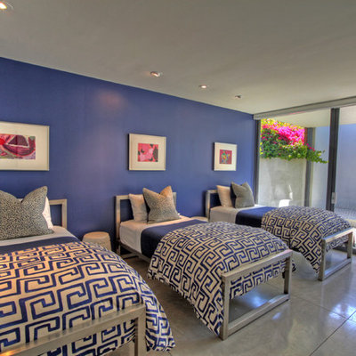 Example of a trendy guest bedroom design in Orange County with blue walls
