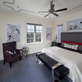 Example of a mid-sized classic guest carpeted and beige floor bedroom design in Orlando with beige walls and no fireplace