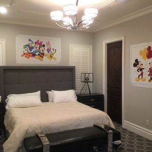 Mid-sized elegant guest carpeted and beige floor bedroom photo in Orlando with beige walls and no fireplace