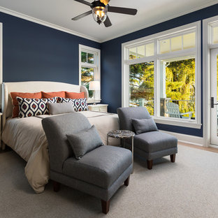 Inspiration for a beach style master light wood floor bedroom remodel in Grand Rapids with blue walls