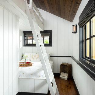 Bedroom - rustic guest medium tone wood floor and brown floor bedroom idea in Other with white walls