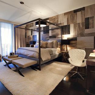 Esempio di una camera da letto moderna con parquet scuro e nessun camino