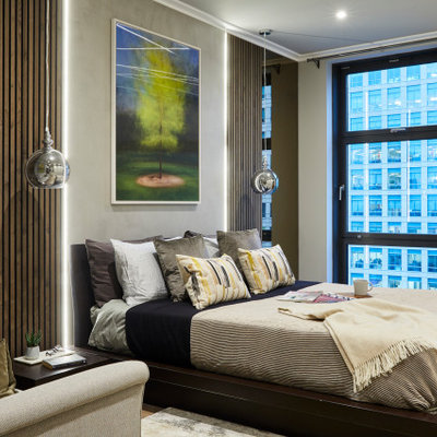 Large trendy master brown floor bedroom photo in London with gray walls