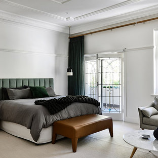 Inspiration for a transitional master bedroom in Melbourne with white walls, carpet and white floor.