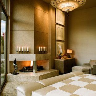 Ejemplo de dormitorio principal, actual, de tamaño medio, con paredes beige, moqueta, chimenea de doble cara, marco de chimenea de baldosas y/o azulejos y suelo multicolor