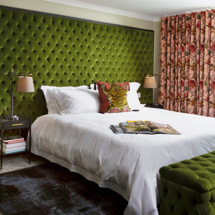 Inspiration for a medium sized bohemian guest bedroom in London with green walls, carpet and grey floors.