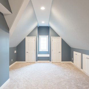 Inspiration for a large transitional loft-style bedroom in Indianapolis with blue walls, carpet and no fireplace.