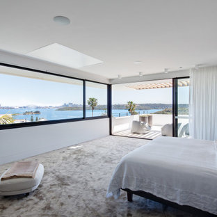 Modern bedroom in Sydney with white walls, carpet and grey floor.