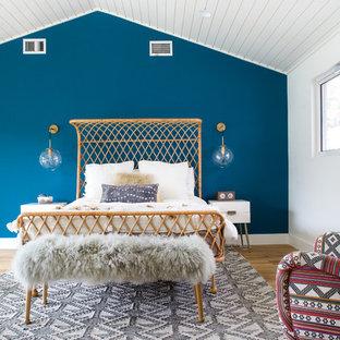 Bedroom - mid-sized 1960s master light wood floor bedroom idea in Orange County with blue walls