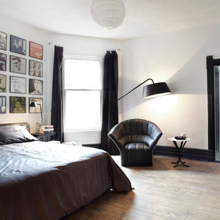 Bedroom - contemporary medium tone wood floor bedroom idea in Toronto with white walls and no fireplace