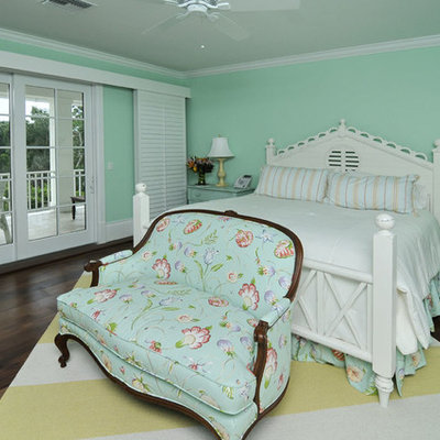 Example of a classic dark wood floor bedroom design in Miami with green walls and no fireplace