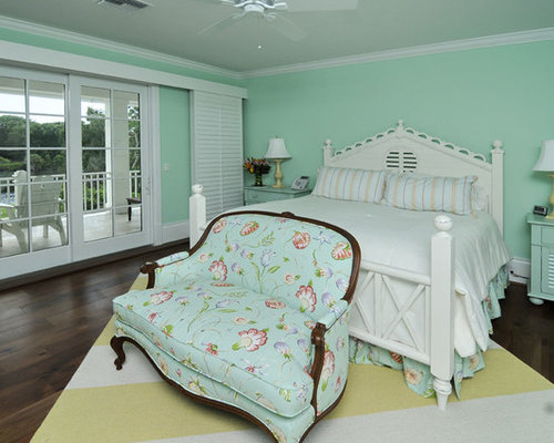 example of a classic bedroom design in miami with green walls and dark hardwood floors - Mint Green Bedroom Decorating Ideas