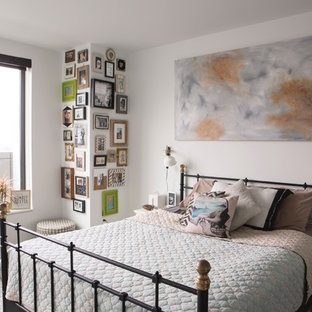 Bedroom - mid-sized eclectic master carpeted and multicolored floor bedroom idea in Portland with white walls and no fireplace