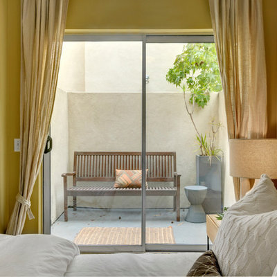 Example of a trendy bedroom design in San Diego with yellow walls