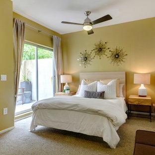 Bedroom - contemporary bedroom idea in San Diego with yellow walls