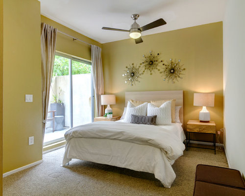 Contemporary bedroom idea in San Diego with yellow walls