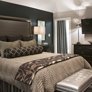 This is an example of a medium sized traditional guest bedroom in Los Angeles with black walls, carpet and grey floors.