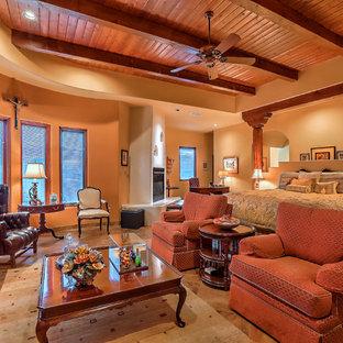 Imagen de dormitorio principal, de estilo americano, de tamaño medio, con paredes amarillas, suelo de pizarra, chimenea tradicional, marco de chimenea de yeso y suelo multicolor