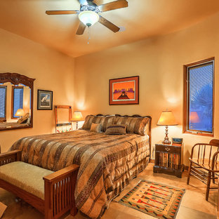 Design ideas for a mid-sized master bedroom in Albuquerque with yellow walls, slate floors, a standard fireplace, a plaster fireplace surround and multi-coloured floor.