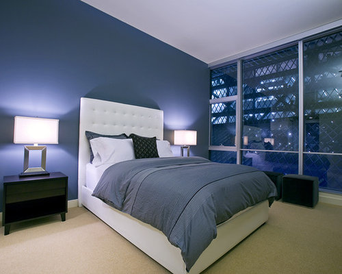 example of a trendy bedroom design in seattle with blue walls - Bedroom Design Blue