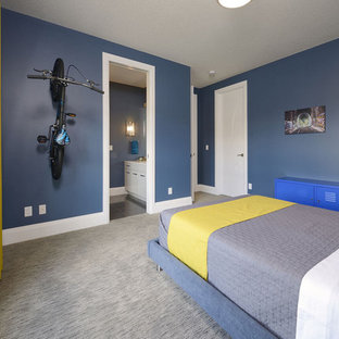 Example Of A Large Trendy Carpeted Bedroom Design In Edmonton With Blue  Walls