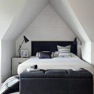 Small contemporary guest bedroom in London with grey walls, carpet and no fireplace.