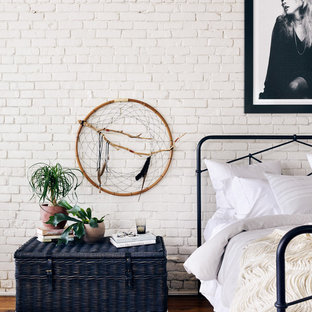 Inspiration for a scandinavian loft-style light wood floor bedroom remodel in Charlotte with white walls