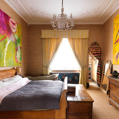 Inspiration for an eclectic carpeted bedroom remodel in London with brown walls