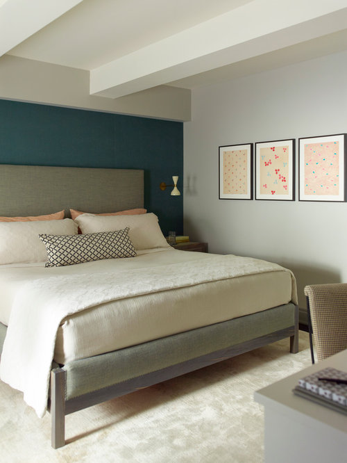 Transitional master bedroom idea in New York with blue walls