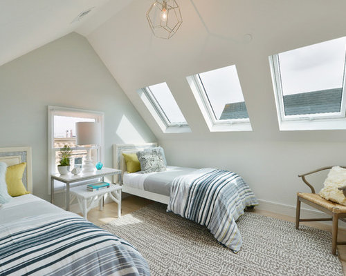 inspiration for a small contemporary guest bedroom remodel in san francisco with light hardwood floors