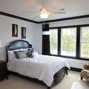 This is an example of a traditional bedroom in Other with white walls and carpet.