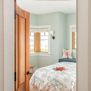 Bedroom - mid-sized coastal master light wood floor and brown floor bedroom idea in Portland Maine with blue walls and no fireplace
