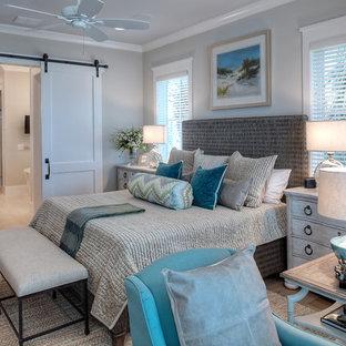 Bedroom - beach style medium tone wood floor and brown floor bedroom idea in Other with gray walls
