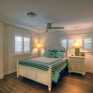 Example of a mid-sized island style guest porcelain floor bedroom design in Tampa with beige walls and no fireplace