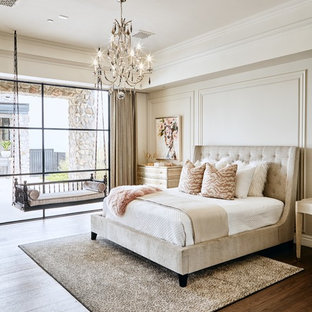 Example of a transitional dark wood floor and brown floor bedroom design in Phoenix with beige walls