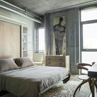 Bedroom - large industrial guest light wood floor bedroom idea in Los Angeles with gray walls and no fireplace