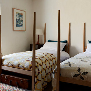 This Is An Example Of A Medium Sized Country Guest Bedroom In London With  Beige Walls