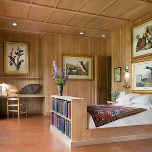 Design ideas for a small transitional master bedroom in New York with concrete floors, brown walls and brown floor.