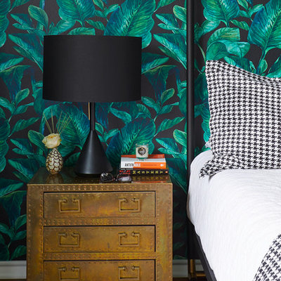 Bedroom - mid-sized eclectic master medium tone wood floor and brown floor bedroom idea in Austin with multicolored walls