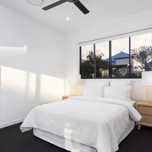 Contemporary bedroom in Brisbane with white walls, carpet and black floor.