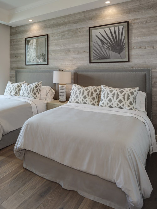 Best Beach Style Bedroom Design Ideas   Remodel Pictures   Houzz Example of a coastal bedroom design in Cleveland with medium tone hardwood  floors. Beach Style Bedroom. Home Design Ideas